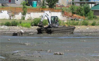 Hurricane Clean-up in a Alabama Lake using a Wilson Amphibious Excavator