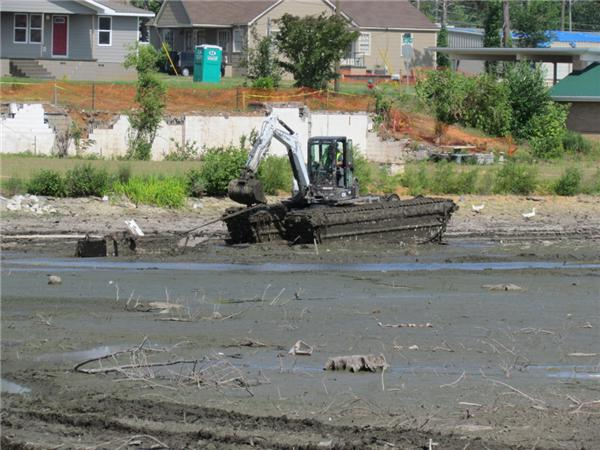 Hurricane Clean-up in a Alabama Lake using a Wilson Amphibious Excavator